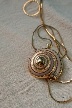 Gold Rimmed Seashell Necklace  Shark Eye by holliewouldvintage, $22.00