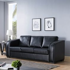 Modernize your living room with this comfy sofa. This sofa features firm seats with pocket coil cushions and piping design. The handsome black finish allows for a sleek modern feel.