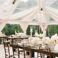"Playing off the array of candles lining the tables, several crystal chandeliers overhead warmed up the room and helped build   a more intimate look. ""Whether it's 3 or 50, if placed right, the romance and style that's given from chandeliers is unparalleled,"" Sacks says. ""And the light given off from tons of flickering candles can be mesmerizing."""