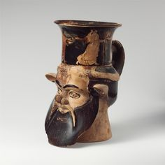 Terracotta mug in the form of a satyr's head, Greek, Classical, 460B.C., Attributed to the Carlsruhe Painter; Attributed to the Manchester Class of Head Vases
