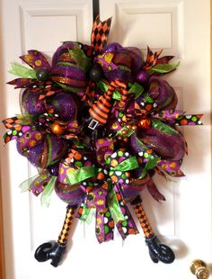 Whimsical Halloween Witch Wreath with  a Funky Hat and Legs by AnySeasonAnyReason on Etsy https://www.etsy.com/listing/243617192/whimsical-halloween-witch-wreath-with-a