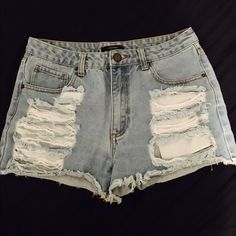 F21 Distressed High Waisted Shorts Only worn them a couple times, no damage, haven't been worn in like two years and ive dropped a few sizes since then so these are now too big on me.                                                   (Forever 21 sizes go by waist size).                        NOT BRANDY MELVILLE Brandy Melville Shorts Jean Shorts