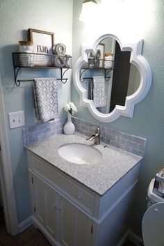 Guest Bathroom Makeover Bathroom Decor Sea Salt by Sherwin Williams Grey Granite Countertop White Grey Vanity Quatrefoil Mirror Hanging Shelf Neutral Decor Farmhouse Style Clean Fresh Straight Lines Before and After Bathroom Counter Organization, Bathroom Storage, Organization Hacks, Towel Storage, Bathroom Counter Decor, Bathroom Bin, Bathroom Stuff, Bathroom Shelves, Bathroom Wall Baskets