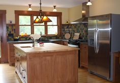 Perfect kitchen layout that can be used in any house. Tile backsplash is cheap to do yourself. Large island makes up for all the extra storage you lose with the upper cabinets.