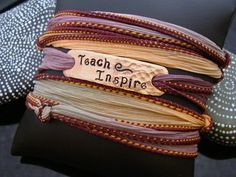 """hammered and hand stamped """"Teach Inspire"""" silk ribbon wrap bracelet with magnetic clasp. $35.00, via Etsy."""