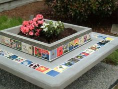 Concrete planter with bench seat.  Tiles were made by children and then grouted into the planter and seat.  Great school project idea. Also an eye-catching project for parks, playgrounds, and community areas.