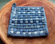 Weaving and sewing denim strips into pot holders and place mats ( This is what we could do with that leftover denim from the other craft!)