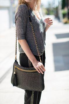 very similar, much cheaper version of this bag here:  http://shop.nordstrom.com/s/nb-handbags-studded-convertible-crossbody-medium-juniors/3498442?