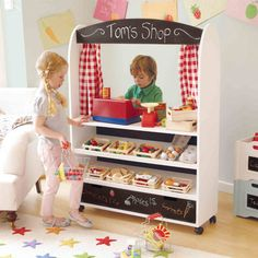 Play Shop and Theatre - storage drawer at bottom & wheels to rotate for a puppet show or theatre or just to wheel away at the end of play