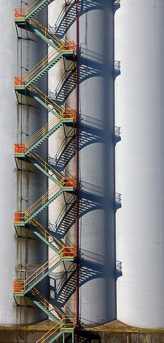Stairs at the Cascadia Grain Terminal in Vancouver.but don't pay as much attention to the stairs as to the shadow the stairs cast. Grand Staircase, Spiral Staircase, Staircase Design, Stairs Architecture, Architecture Details, Balustrades, Exterior Stairs, Fire Escape, Take The Stairs