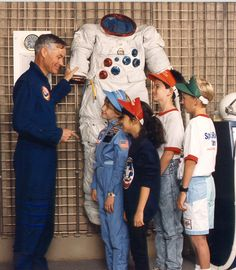 Astronaut Mike Mullane talks with a group of space campers.