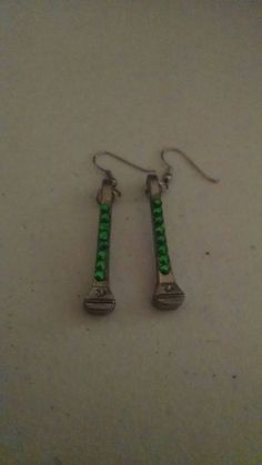 Check out this item in my Etsy shop https://www.etsy.com/listing/245454558/green-rhinestone-accented-horseshoe-nail