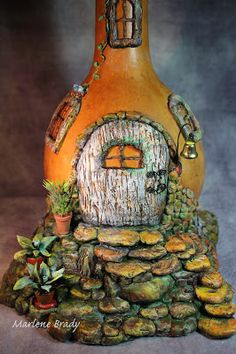"""Out of Her Gourd"" x x (high) Gourd: From a Second Hand Store Base & Rock Armature: Aluminum Foil & Tape Bas. Glass Bottle Crafts, Wine Bottle Art, Plastic Bottles, Glass Bottles, Clay Fairy House, Fairy Houses, Fairy Crafts, Jar Art, Clay Fairies"