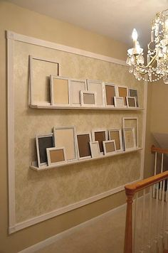 Accent photo gallery wall - I love this!  No more leveling things up & then putting way too many holes in the wall to hang one photo. This is amazing... don't know where i'd use it.. but I like it.