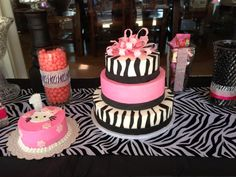 Three tier cake covered in buttercream, only the zebra stripes and bow are fondant