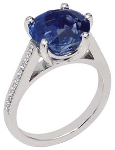 Chaumet Frisson engagement ring in white gold with diamonds and a sapphire