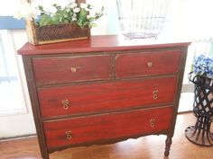 Antique dresser distressed in a red and brown.