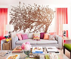 This living room is bursting with color! See the rest of this colorful & vibrant California apartment:  http://www.bhg.com/decorating/small-spaces/apartments/colorful-vibrant-california-apartment/?socsrc=bhgpin082313treemural