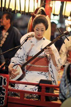 Playing the shamisen