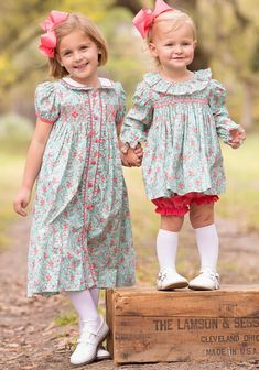 Our Tatum Smocked Dress will be a gorgeous addition to your little girls closet! Beautiful floral fabric hand smocked and detailed in coral corduroy fabric. 100% cotton, see size guide.