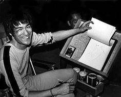 Bruce Lee sketching on the set for Game of Death.