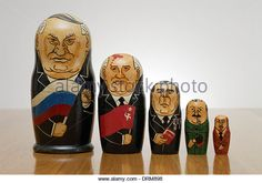 Russian Matryoshka dolls painted as Russian leaders. L- R; Yeltsin, Gorbachev, Brezhnev, Stalin, Lenin. - Stock Image