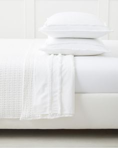 A crisp percale sheet in always-right white is a bedding essential. What makes ours noteworthy  are two thin rows of fringe that take the look from everyday to elevated. Utterly perfect as part of an all-white scheme, but equally wonderful with a pop or two of color.