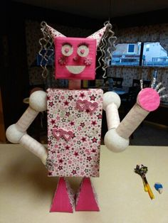 Project : create a robot using 3D shapes (rectangle, cube, sphere, cone, pyramid, cylinder ) This is what we came up with! Her name is 'Jewels'.... get it?