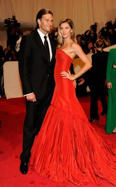 "Tom Brady & Gisele Bundchen in Alexander McQueen at the 2011 Met Gala ""Alexander McQueen: Savage Beauty."" Photo by Getty Images."
