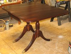 This was nearly a piece of junk! Needed reglue, a new toe and lots of TLC. Duncan Phyfe Drop Leaf Table