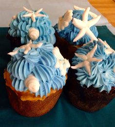 """Our """"Jersey Shore Cupcake"""", rich chocolate or vanilla cake frosted with our special buttercream blend with a seashell accent."""