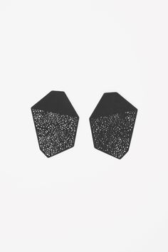 These earrings are an angular shape with a fine laser-cut design. They are made for pierced ears.