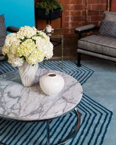 Flowers - White hydrangeas on a marble-topped table and area rug at Jessica Alba's Honest Company office