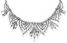 A VERY FINE ANTIQUE DIAMOND AND SILVER NECKLACE, CIRCA 1860. Of garland and foliage design, mounted in gold and silver and set with old- and rose-cut cut diamonds.