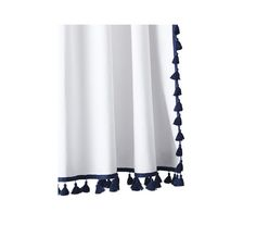 A crisp white cotton curtain is sure to make your bathroom feel clean and serene.