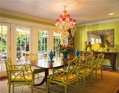 Dramatic colorful and tropical dining room.