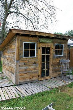 Shed made from pallets and tin cans.  could be made for chicken coop or rabbit hutches.
