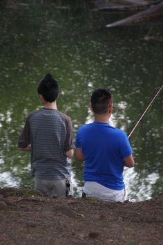 Two young guys fishing by a pond in Lacamas Creek Park, Camas, WA.  04/2014.