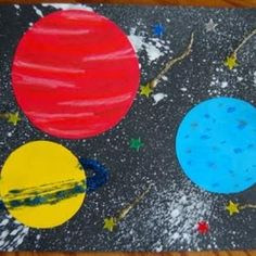 Outerspace art: toothbrush splatters for the background.  * Mary I would use some other kind of brush if this project looks like something you'd want to do.