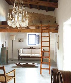 Love the rustic setting with a big frilly chandelier! Villa Ibiza