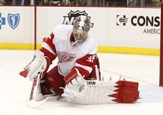 CrowdCam Hot Shot: Detroit Red Wings goalie Jimmy Howard makes a save against the Pittsburgh Penguins during the second period at the CONSOL Energy Center. Photo by Charles LeClaire