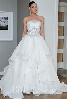 Can't get over the layers on the skirt of this @alynebridal wedding dress | Brides.com