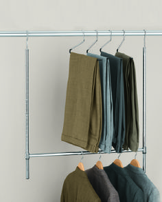 "Have more slacks and shirts than long coats and dresses? Reconfigure the closet in a snap with this ""closet doubler"" which creates an extra hanging bar for clothes."