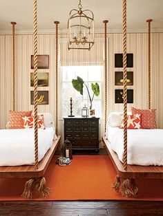 suspended teak platform beds + tangerine + stripes. I have wanted to do this forever. When the boys were younger, I think he didn't want me to hang anything from the ceiling. Looks so awesome. And I think I need to find that orange starfish fabric now for the living room.