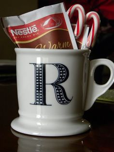 hot chocolate mix + mug + candy cane = perfect gift for coworkers, teachers, post office employees, etc.