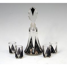 Decanter set with four gobblets with an Art Deco enameled decoration.  Made in France                  Circa: 1930
