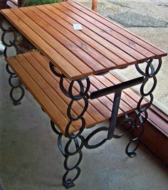 Horseshoe table, (I've got to learn to weld) ...this could have a metal or tempered glass top and shelf so it could stay on the patio all year long.