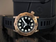 Steve Laughlin is raising funds for Benarus Megalodon Dive Watch on Kickstarter! The Megalodon, by Benarus, is the ultimate dive watch using the highest quality of materials and technologies possible today. Bronze, Best Affordable Watches, Luxury Restaurant, Megalodon, Time Capsule, Luxury Watches For Men, Watches Online, Chronograph, Diving