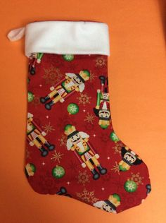 A personal favorite from my Etsy shop https://www.etsy.com/listing/253660737/handmade-christmas-stocking-classic