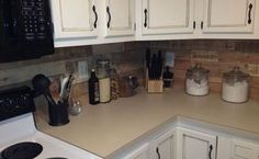 kitchen backsplash made from recycled pallets, kitchen backsplash, kitchen design, pallet, Very easy to do I just cut the pallets with a skill saw then sanded both sides of the boards Then used liquid nail to attach the boards to the backsplash